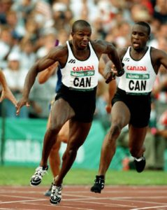 Canada's Donovan Bailey (foreground) and Bruny Surin compete in the men's 4x100m relay at the 1996 Atlanta Summer Olympic Games.(CP Photo/COA/ Claus Andersen) Donovan Bailey et Bruny Surin (de gauche à droite) du Canada participent au relais 4 x 100 m aux Jeux olympiques d'Atlanta de 1996. (Photo PC/AOC)